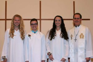 Pictured left to right: Logan Edwards, Joshua Barker, Elaina Riley, and Pastor Rathjen.